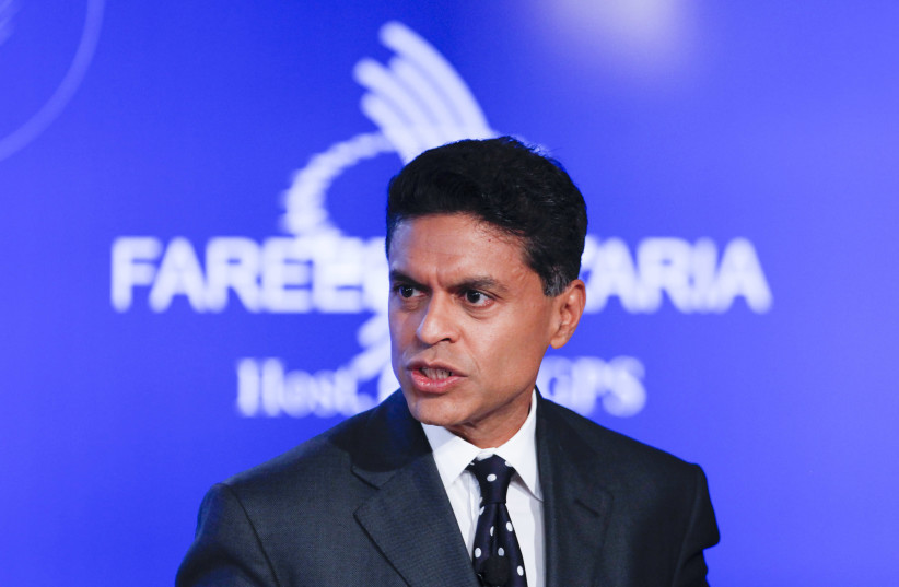 """Television journalist Fareed Zakaria hosts a group discussion on """"Business by Design: Business with Integrity"""" during the second day of the Clinton Global Initiative 2012 (CGI) in New York on September 24, 2012. (photo credit: LUCAS JACKSON / REUTERS)"""