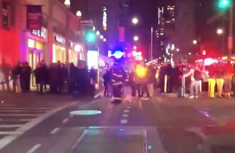 Fire and emergency personnel gather at a scene after explosions were heard in New York (photo credit: SOCIAL MEDIA)