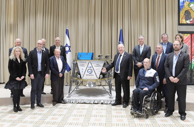 Reuven Rivlin (C) at a ceremony with a probe that will be sent to the moon, February 17th, 2019 (photo credit: AMOS BEN-GERSHOM/GPO)