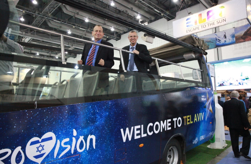 Tel Aviv Mayor Ron Huldai and Tourism Minister Yariv Levin aboard a 'Eurovision' bus (photo credit: NOA GUTMAN)