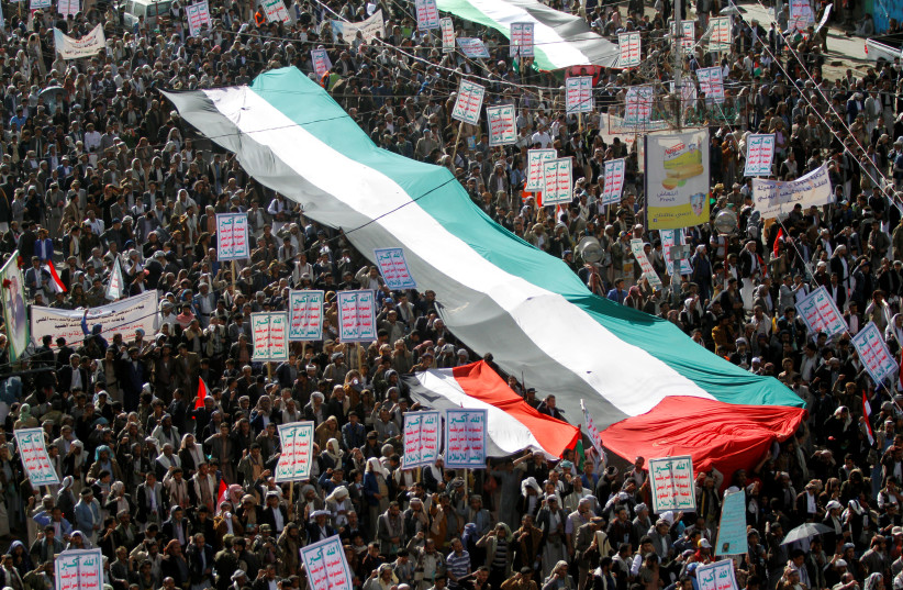 Protesters gather during a rally against the Middle East conference in Warsaw, in Sanaa, Yemen February 17, 2019  (photo credit: REUTERS/MOHAMED AL-SAYAGHI)
