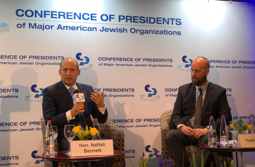 Minister of Education Naftali Bennet with Jerusalem Post Editor-in-Chief Yaakov Katz at the Conference of Presidents of Major American Jewish Organizations, Feb. 18, 2019. (photo credit: YANIR COZIN / MAARIV)
