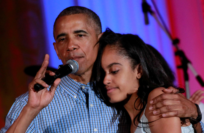 U.S. President Barack Obama congratulates his daughter Malia on her birthday during the Independence Day celebration at the White House in Washington U.S., July 4, 2016. (photo credit: YURI GRIPAS / REUTERS)