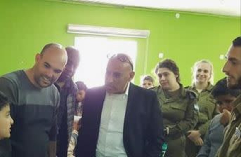 Dr. Muhammad Alhaib, supervisor of Bedouin education in the Ministry of Education, alongside IDF soldiers in the city of Rahat  (photo credit: FACEBOOK)