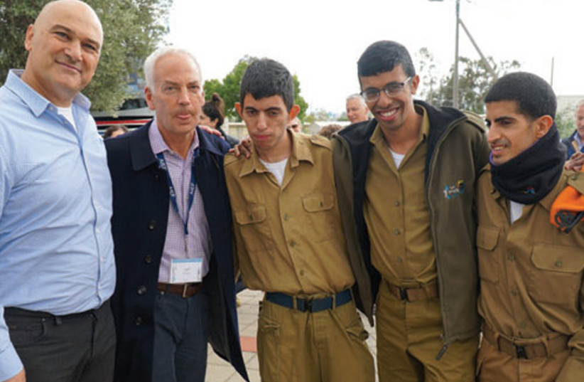 Tiran Attia, Director of Special in Uniform, and Jeff Farber, CEO of the Koret Foundation, with soldiers serving in Special in Uniform (photo credit: YOSSI KAHANA)
