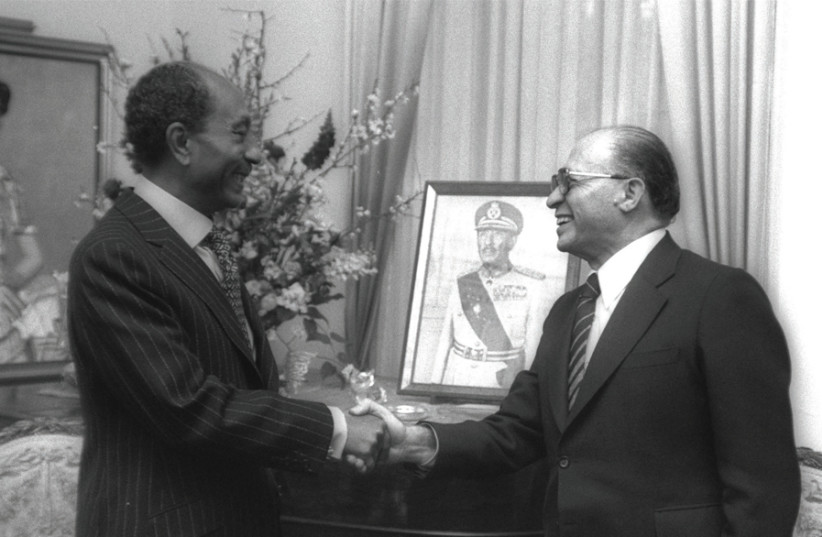 Prime Minister Menachem Begin meets with Egyptian President Anwar Sadat at the Egyptian Embassy in Washington before signing the Egypt-Israel Peace Treaty 40 years ago (photo credit: YAACOV SAAR/GPO)