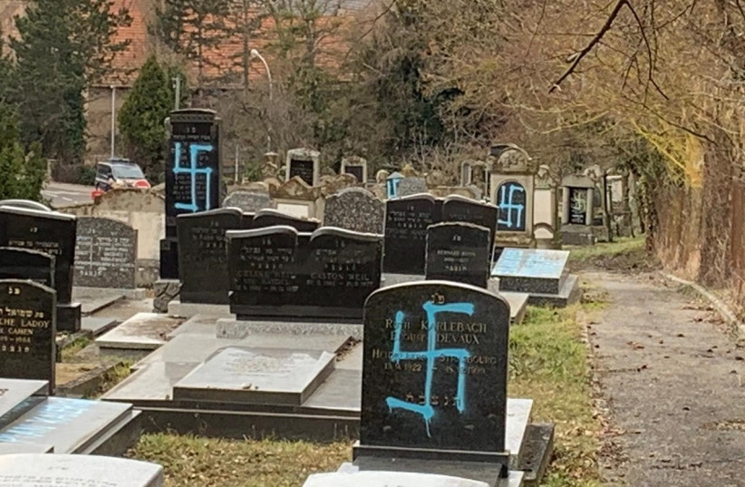 Gravestones at the Jewish cemetery in Quatzenheim, France, vandalized with Nazi graffiti, February 19. (photo credit: CONSISTOIRE OF THE LOWER RHINE)