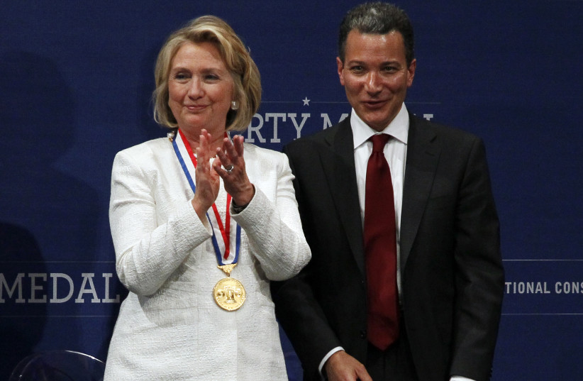 Former U.S. Secretary of State Hillary Rodham Clinton (L) applauds after being awarded the 2013 Liberty Medal by Jeffrey Rosen (R), president and CEO of the National Constitution Center, during a ceremony in Philadelphia, Pennsylvania September 10, 2013 (photo credit: TOM MIHALEK / REUTERS)