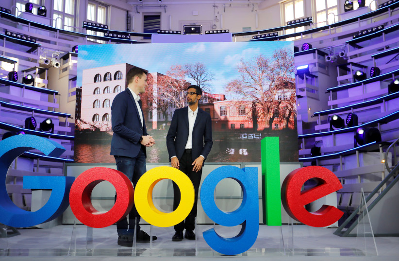 Google CEO Sundar Pichai and Philipp Justus, Google Vice President for Central Europe and the German-speaking Countries, stay at a Google logo during the opening of the new Alphabet's Google Berlin office in Berlin, Germany, January 22, 2019. (photo credit: HANNIBAL HANSCHKE/REUTERS)