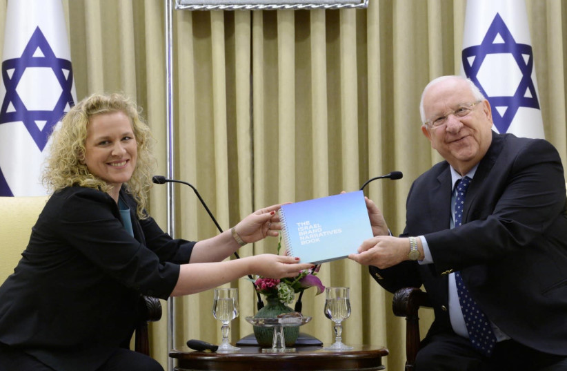 CEO of Vibe Israel Joanna Landau [L] and to President Reuven Rivlin [R] at the presentation of the new study conducted by Bloom Consulting for Vibe Israel  (photo credit: MARC NEYMAN/GPO)