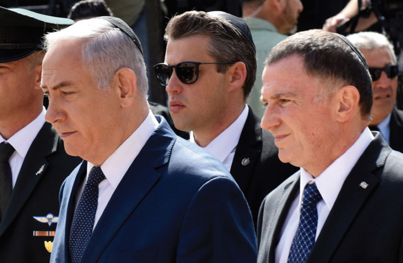 EDELSTEIN AND Prime Minister Benjamin Netanyahu arrive at the Yad Vashem ceremony marking 2018 Holocaust Remembrance Day. Coming in first in the Likud primary puts Edelstein in a prime position to take Netanyahu's place as party leader one day. (photo credit: REUTERS)