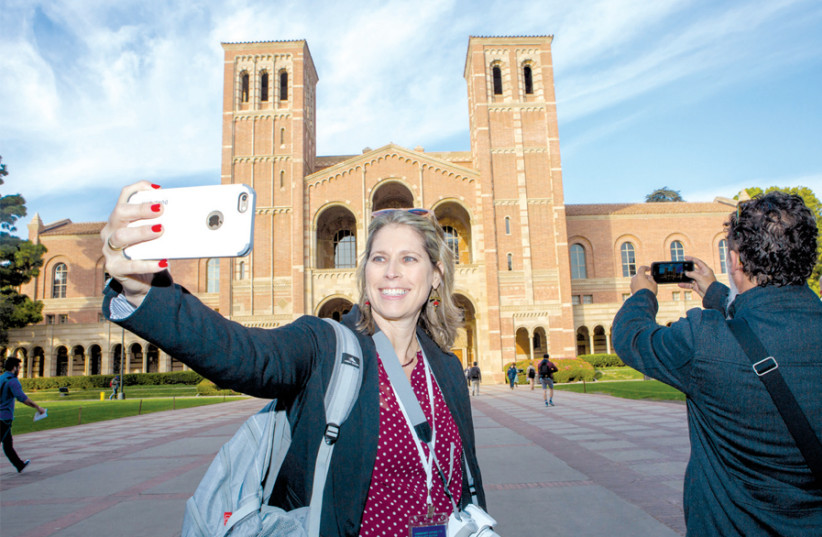 TAL SCHNEIDER, part of the delegation to Los Angeles, snaps a selfie. (photo credit: GESHER)