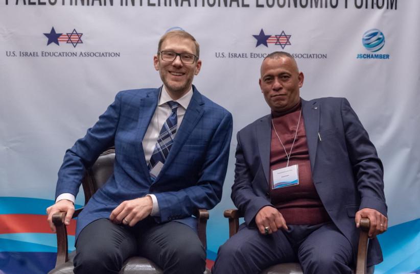 Judea Samaria Chamber of Commerce and Industry co-founders Avi Zimmerman and Ashraf Jabari  (photo credit: EITAN TAL)