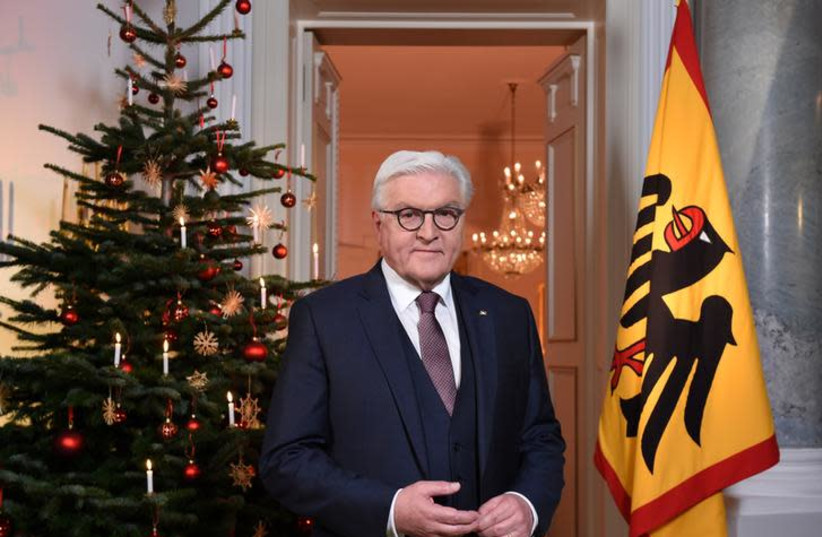 German President Frank-Walter Steinmeier poses after the recording of the traditional Christmas message at Bellevue Palace in Berlin (photo credit: REUTERS)