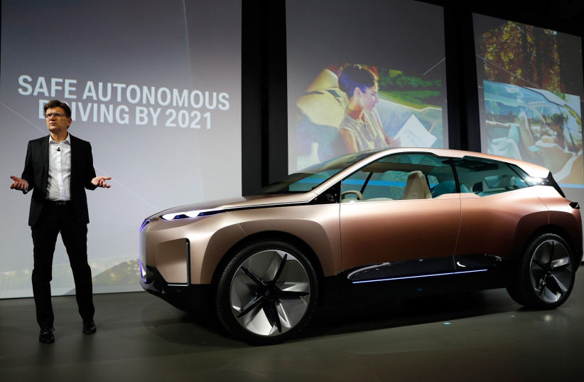 Klaus Frohlich, member of the Board of Management of BMW AG, Development, introduces the BMW Vision iNEXT electric autonomous concept car during a BMW press conference at the Los Angeles Auto Show in Los Angeles, California, U.S. November 28, 2018 (photo credit: REUTERS/MIKE BLAKE)