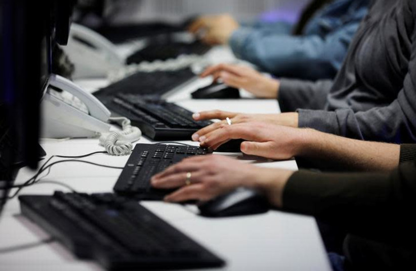 Employees, mostly veterans of military computing units, use keyboards as they work at a cyber hotline facility at Israel's Computer Emergency Response Centre (CERT) in Beersheba, southern Israel (photo credit: REUTERS/AMIR COHEN)