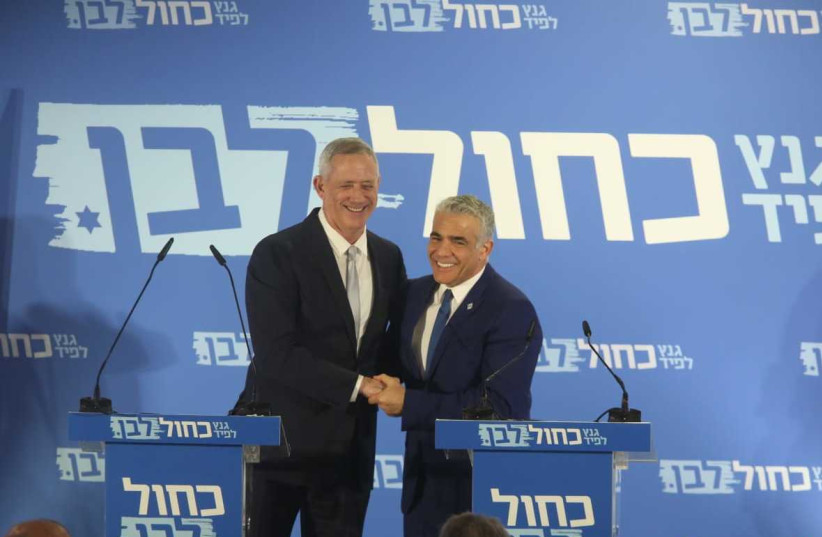 Benny Gantz (L) and Yair Lapid (R) anounce the Blue and White Party (photo credit: MARC ISRAEL SELLEM/THE JERUSALEM POST)