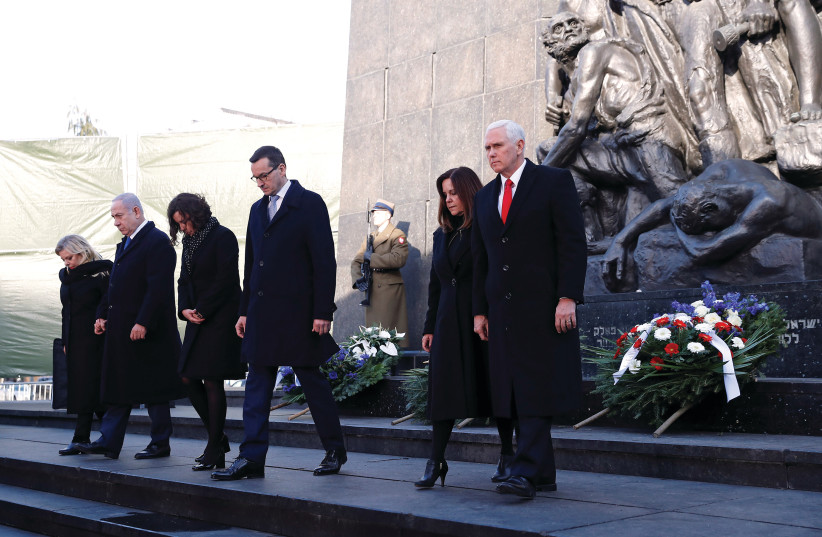 The monument to the Ghetto Heroes in Warsaw, after a wreath-laying ceremony last week attended by (right to left): US Vice President Mike Pence and his wife, Karen; Polish Prime Minister Mateusz Morawiecki and his wife, Iwona; and Prime Minister Benjamin Netanyahu and his wife, Sara (photo credit: REUTERS)
