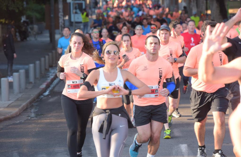 Runners in the Tel Aviv marathon February 22, 2019 (photo credit: AVSHALOM SASSONI)
