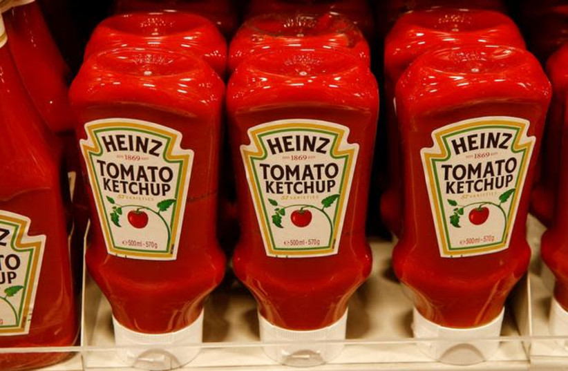 Bottles of Heinz tomato ketchup of U.S. food company Kraft Heinz are offered at a supermarket of Swiss retail group Coop in Zumikon, Switzerland (photo credit: REUTERS/ARND WIEGMANN)