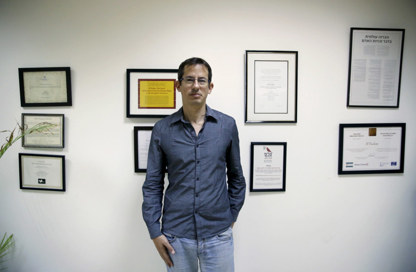 """Hagai El-Ad, Executive Director of B'Tselem, a leading Israeli human rights organisation, poses in his office in Jerusalem December 16, 2015. An ultra-nationalist Israeli group has published a video accusing the heads of four of Israel's leading human rights organizations, including """"B'Tselem"""", of b (photo credit: AMMAR AWAD / REUTERS)"""