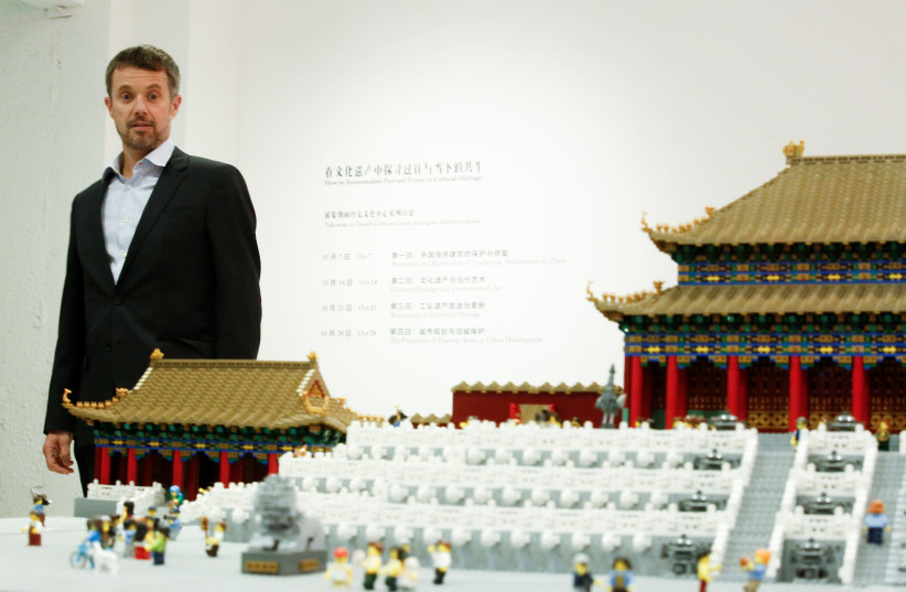 Danish Crown Prince Frederik looks at a model of the Forbidden City made of Lego bricks at the Danish Cultural Center at the 798 art district in Beijing, China, September 23, 2017. (photo credit: REUTERS/THOMAS PETER)
