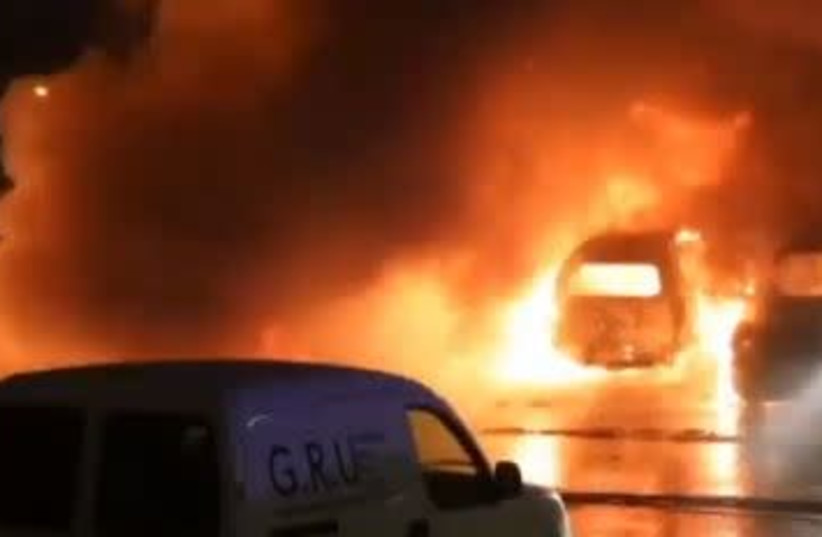 Cars on fire in Sweden (photo credit: screenshot)
