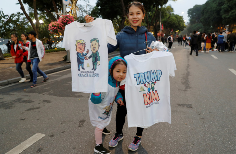 T-shirts depicting North Korea's leader Kim Jong Un and U.S. President Donald Trump for sale on a Vietnamese street ahead of the summit in Hanoi, February 23, 2019 (photo credit: JORGE SILVA / REUTERS)