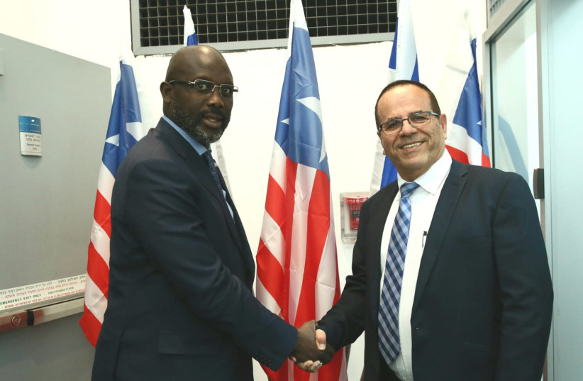 President of Liberia George Weah and Minister of Communications Ayoob Kara (photo credit: MIRI SHIMONOVITZ)
