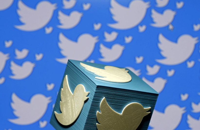 A 3D-printed logo for Twitter is seen in this illustrative picture (photo credit: DADO RUVIC/REUTERS)
