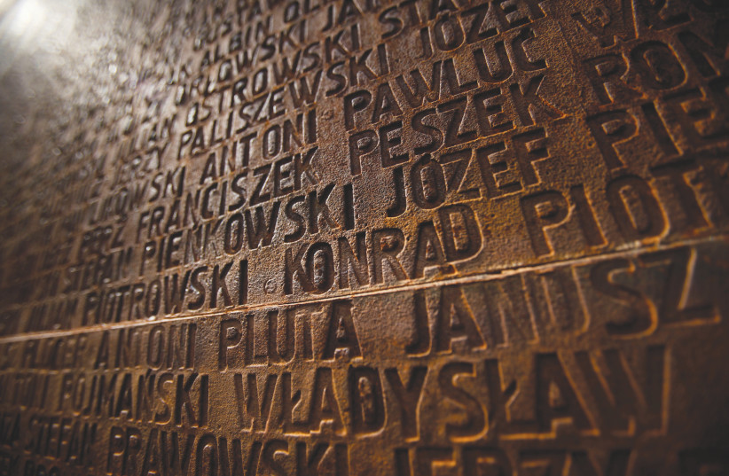 A WALL is inscribed with the names of Polish officers who died, during a commemoration ceremony at a memorial complex in Katyn forest (photo credit: REUTERS)