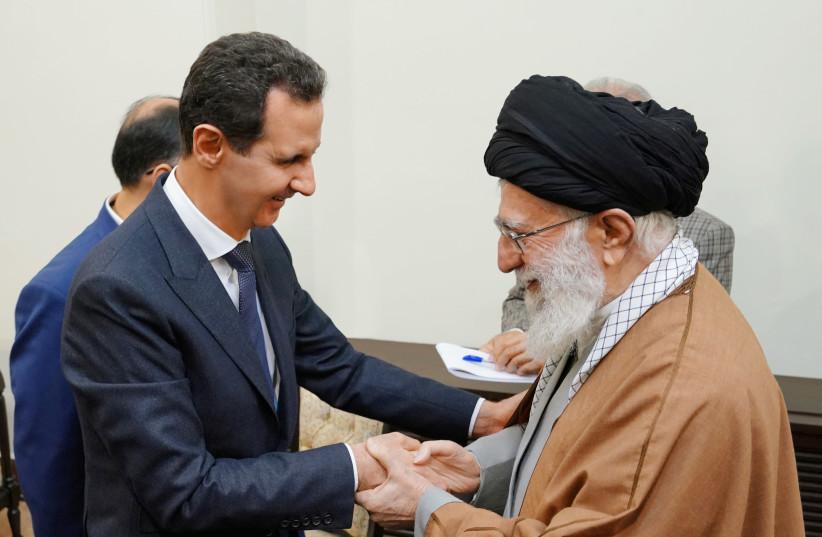Syria's President Bashar al-Assad meets with Iranian Supreme Leader Ayatollah Ali Khamenei in Tehran (photo credit: SANA/REUTERS)