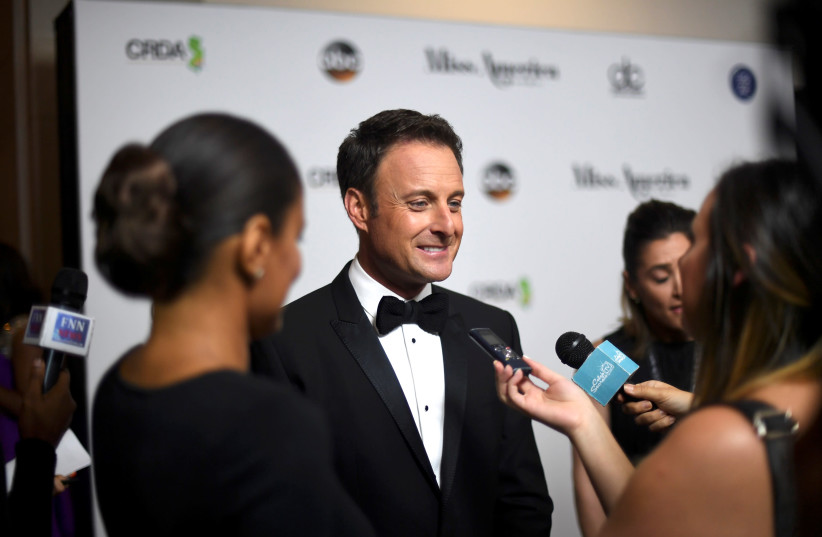 Host Chris Harrison is interviewed on the red carpet of Boardwalk Hall before the 96th Miss America Pageant in Atlantic City, New Jersey, U.S. September 11, 2016. Picture taken September 11, 2016. (photo credit: MARK MAKELA / REUTERS)