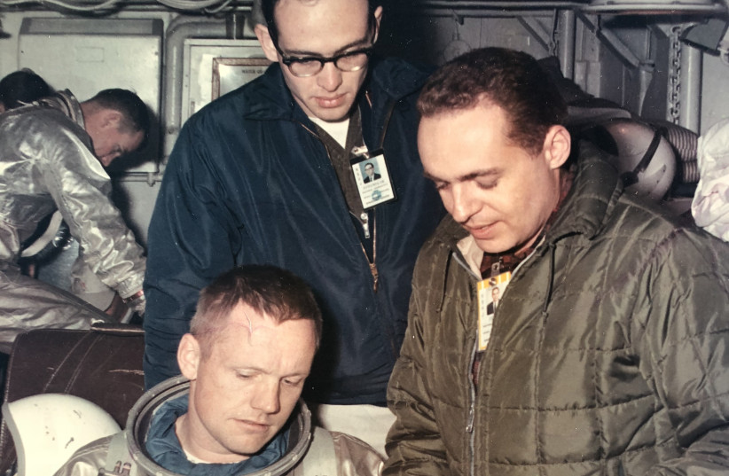 Neil Armstrong (foreground) inspects space suit gloves with Dr.Gerald Ahronheim (R) and NASA flight surgeon Dr. Ken Beers (photo credit: DR. GERALD AHRONHEIM)