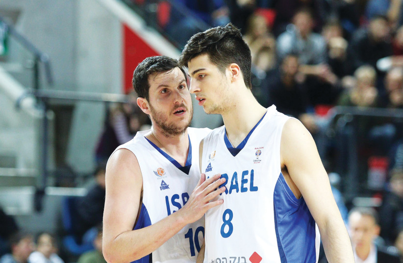 With a strong mix of veterans such as Guy Pnini (left) and young talent, like Deni Avdija (right), Israel had an up-and-down qualification campaign, which ultimately saw the-blue-and-white miss out on a spot in the 2019 FIBA World Cup. (photo credit: ADI AVISHAI)