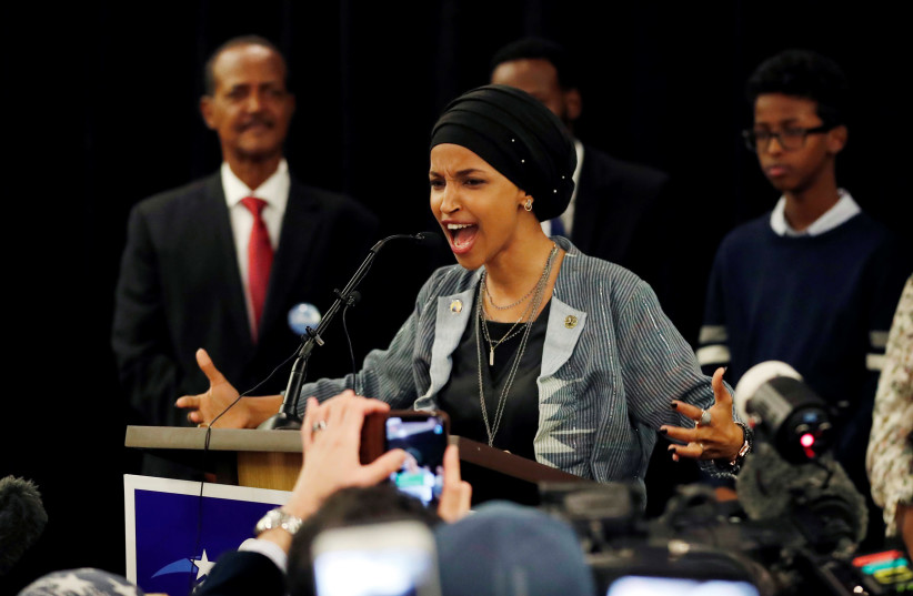 Democratic congressional candidate Ilhan Omar speaks at her election night party in Minneapolis. (photo credit: ERIC MILLER/REUTERS)