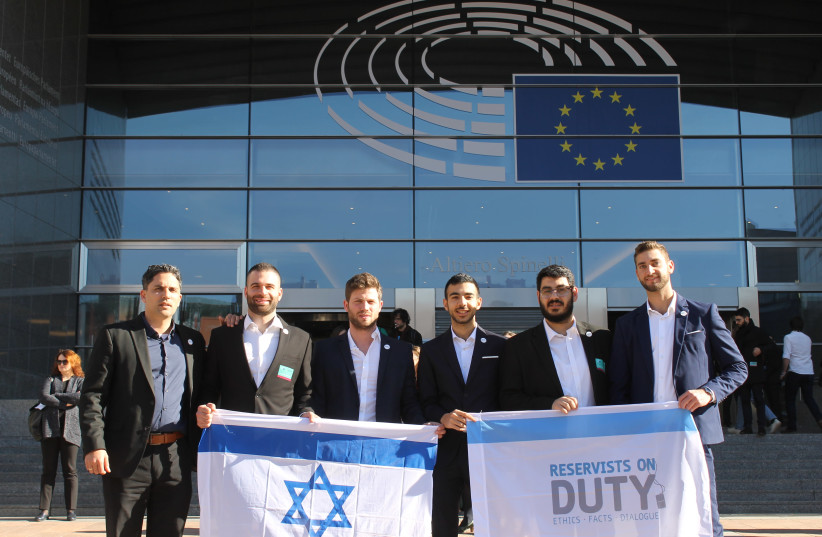The Reservists on Duty delegation stand outside the EU Parliament in Brussels after giving testimonies for the first time (photo credit: ILANIT CHERNICK)