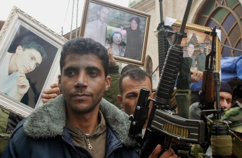 Zakariya Zubeidi, then-leader of the al-Aqsa martyrs brigades looks on during a demonstration supporting Palestinian prisoners in the West Bank city of Jenin, February 10, 2005 (photo credit: REUTERS/SAEED DAHLAN)