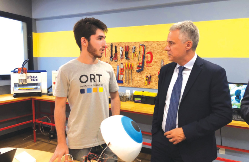 WORLD ORT director-general and CEO Avi Ganon meets a technology student at Escola ORT in Rio De Janeiro, Brazil. (Photos: Courtesy World ORT) (photo credit: COURTESY WORLD ORT)