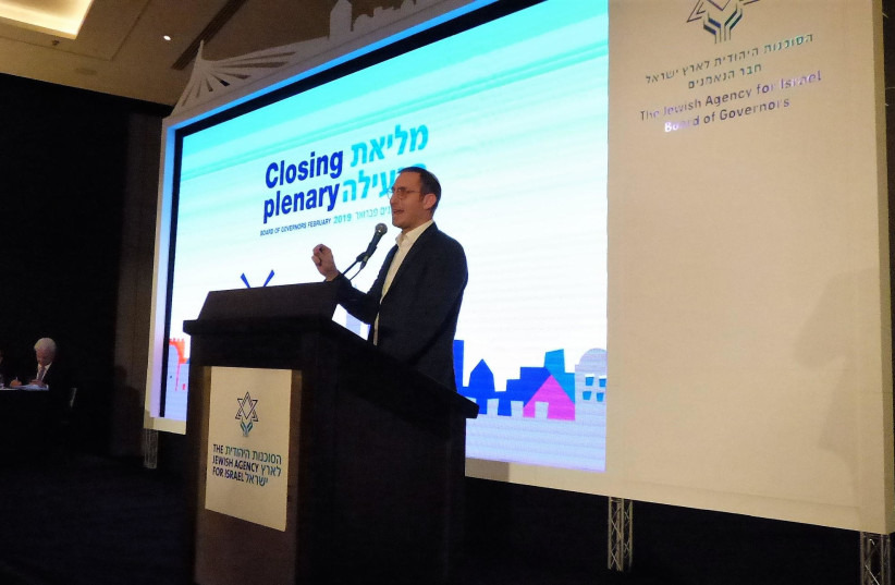 Mosaic United CEO Rabbi Benji Levy announces the launch of 'Shalom Corps' at the closing plenary of the Jewish Agency for Israel's annual Board of Governors meeting in Jerusalem on February 26, 2019. (photo credit: Courtesy)