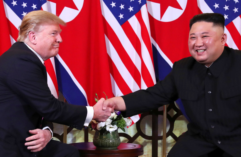 U.S. President Donald Trump and North Korean leader Kim Jong Un shake hands before their one-on-one chat during the second U.S.-North Korea summit at the Metropole Hotel in Hanoi, Vietnam February 27, 2019. (photo credit: LEAH MILLIS/REUTERS)