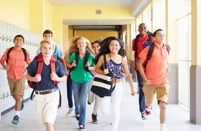 Teens with backpacks (illustrative) (photo credit: INGIMAGE)