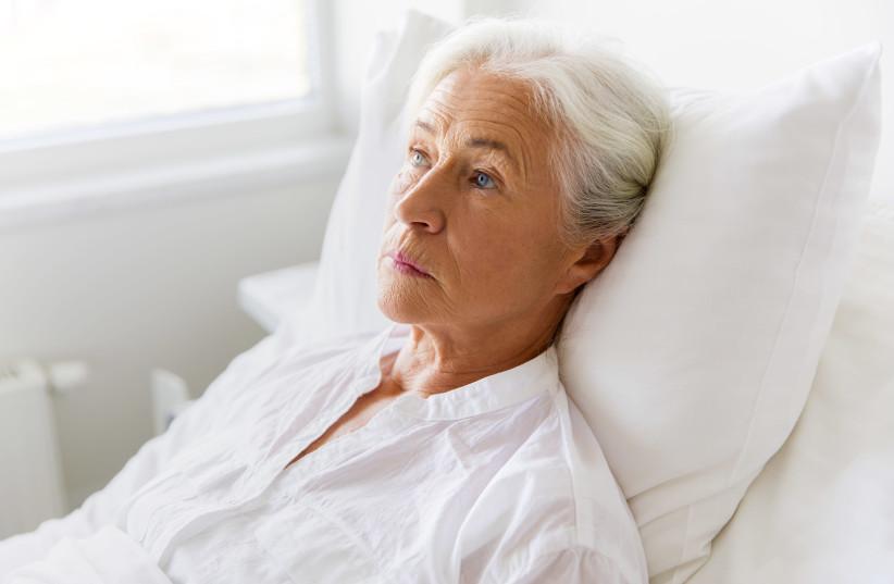 Old woman in hospital bed (illustrative) (photo credit: INGIMAGE)