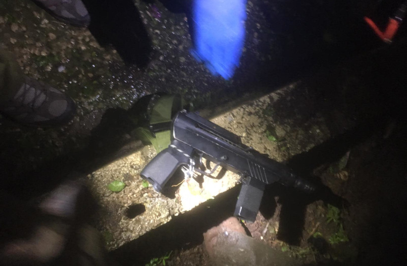A Carlo style automatic rifle discovered in a Palestinian Authority township by IDF soldiers, February 28, 2019 (photo credit: IDF SPOKESMAN'S OFFICE)