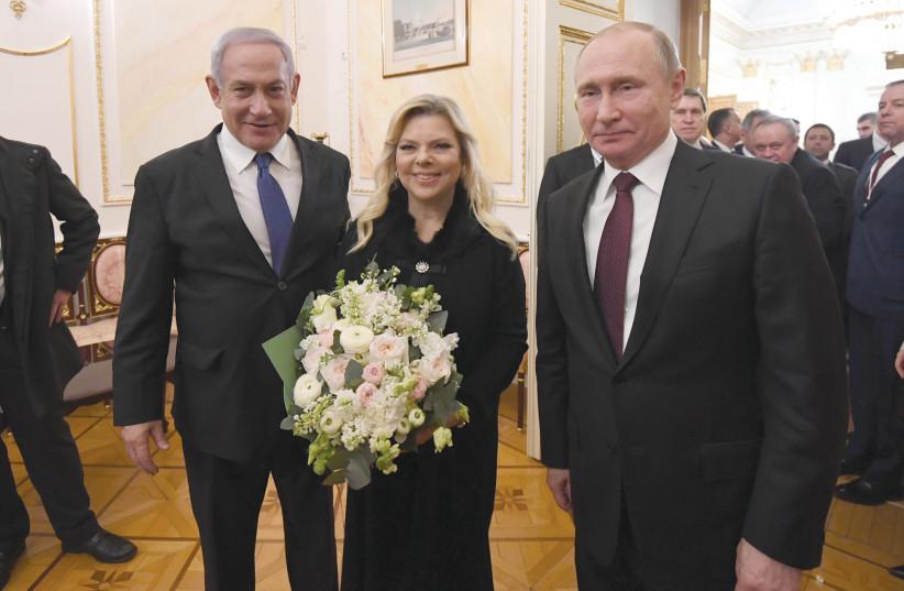 PRIME MINISTER Benjamin Netanyahu and his wife, Sara, enjoy a moment with Russian President Vladimir Putin on Wednesday (photo credit: HAIM ZACH/GPO)