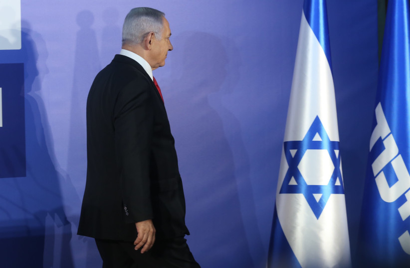 Prime Minister Benjamin Netanyahu walking after speaking against the alleged corruption charges against him (photo credit: MARC ISRAEL SELLEM)