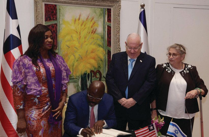 Reuven Rivlin (C-R) and George Weah (C-L) (photo credit: GPO)