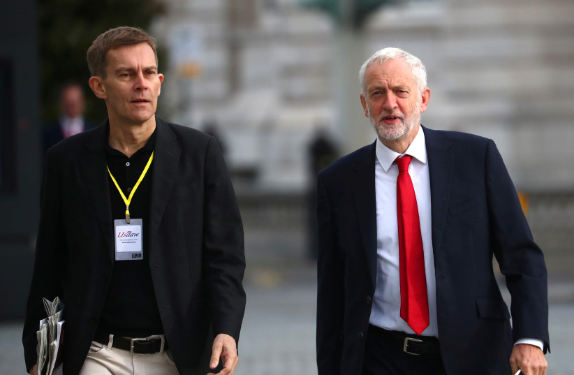 Britain's Labour Party leader Jeremy Corbyn with Seumas Milne. (photo credit: HANNAH MCKAY/ REUTERS)