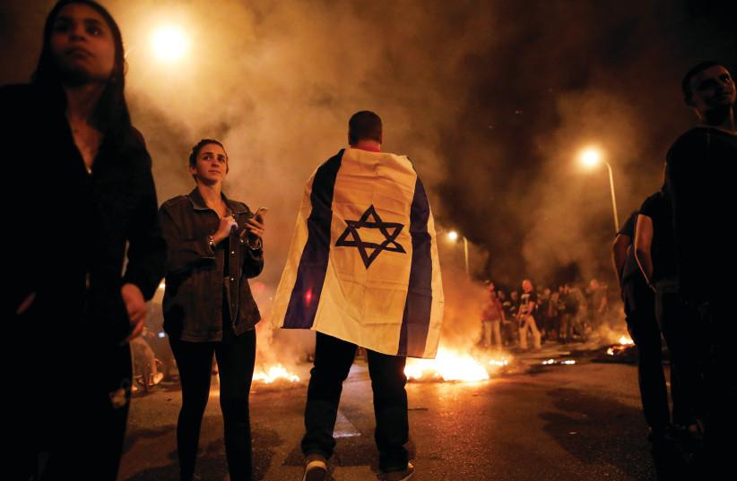 Protesters near the Gaza border last November. (photo credit: REUTERS)