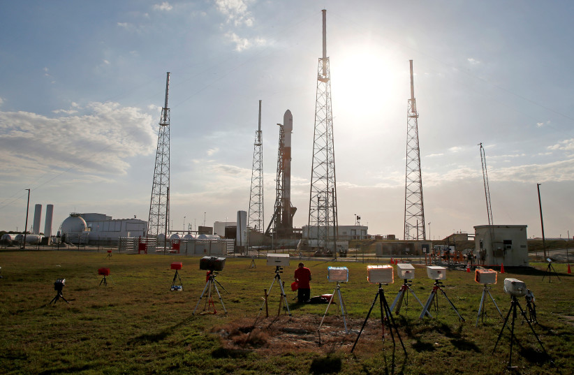 A SpaceX Falcon 9 rocket carrying Israel's first spacecraft designed to land on the moon is prepared for launch at Cape Canaveral in Florida on February 21 (photo credit: REUTERS/JOE SKIPPER)